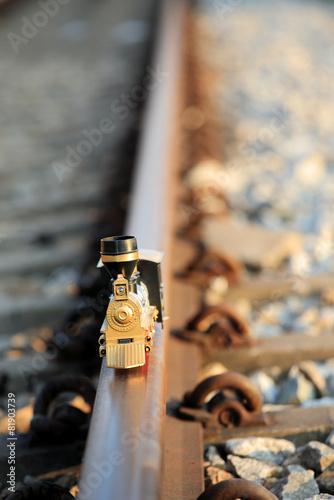 Vintage train toy model on rail.