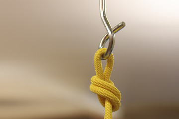 climbing hook with rope knot insurance