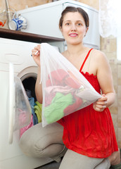 woman  in red  with laundry bag