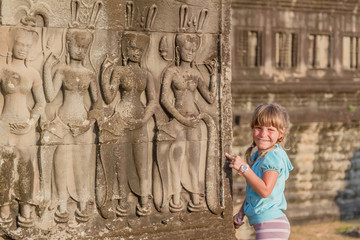 young happy child girl, smiling portrait, angkor wat, cambodia