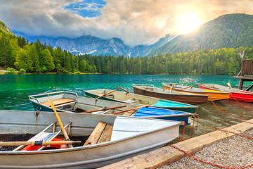 Stunning alpine landscape and colorful boats,Lake Fusine,Italy