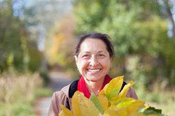 happy mature woman  in autumn