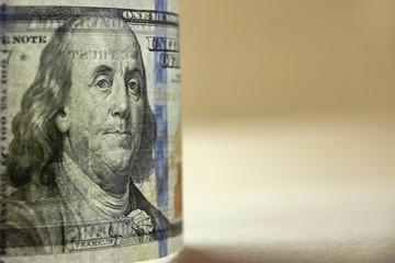 Transparently New USA Hundred Dollar Bill In Back Light Close-up