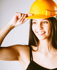 Young Woman Holding her Helmet Over her Head