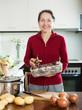 Woman cooking mushrooms