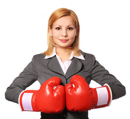 Business woman with boxing gloves isolated