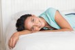 Zdjęcia na płótnie, fototapety, obrazy : Happy brunette lying on bed