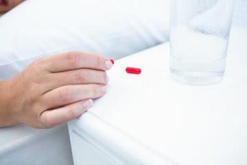 Woman taking pills before sleeping
