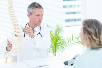 Doctor having conversation with his patient