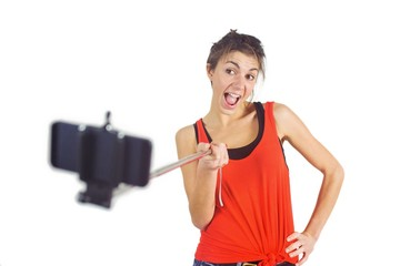 Casual brunette using selfie stick
