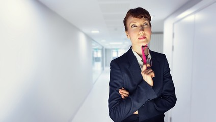 Composite image of thinking businesswoman