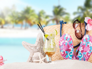 Mojito drink, summer accessories with tropical beach background