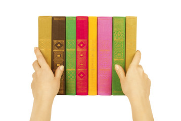 books in hands isolated on a white