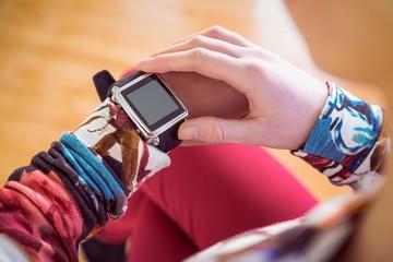 Slim woman using her smartwatch