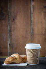 Take away coffee and fresh croissant