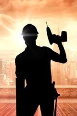 Image of carpenter holding drill machine