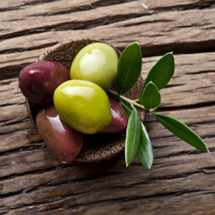 Olives on old wooden table.