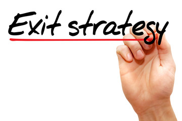 Hand writing exit strategy with marker, business concept