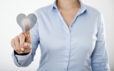 Businesswoman pressing heart icon button on digital touch screen