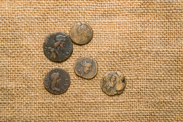 Antique coins with portraits of emperors are on sacking