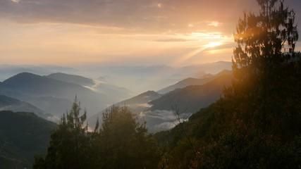 Foggy Himalayas mountains at sunset lights. Nepal