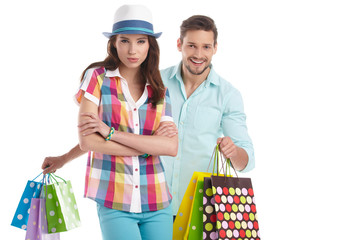 Young, smiling couple on a shopping spree. Shallow DOF, focus on