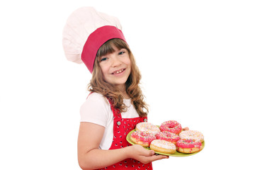 happy little girl cook with sweet donuts