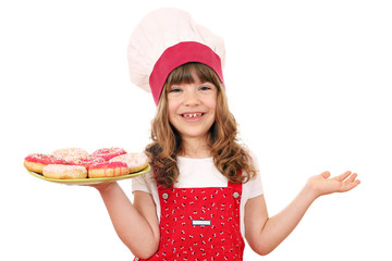 little girl cook with sweet donuts