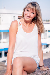 Young beautiful woman in port