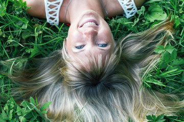 smiling girl lying on the grass