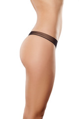 Side view of handsome female body in black panties