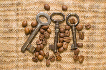 Vintage keys and coffee beans on  cloth