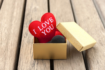 Red heart in gold gift box