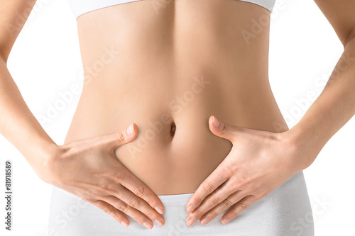 Woman holding hands on a belly. Stomach health concept. Isolated - 81918589