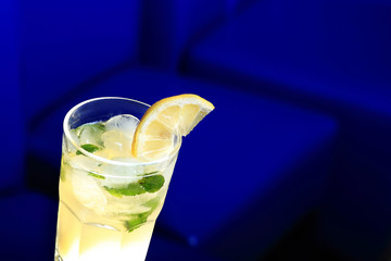 Glass of lemonade with a slice of lemon and mint