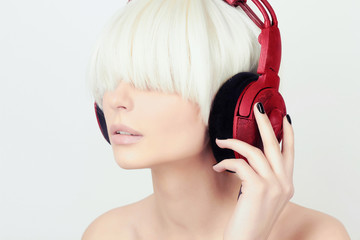 Woman listening music on headphones.dj