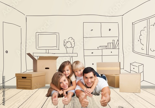 Two. Portrait of happy family showing thumbs up sign while lying