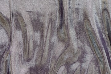 fabric with wavy stains of pale motley color