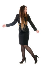 Business woman in full growth is looking back