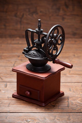 Coffee mill on rustic old wooden table