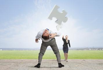 Man evading flying puzzle