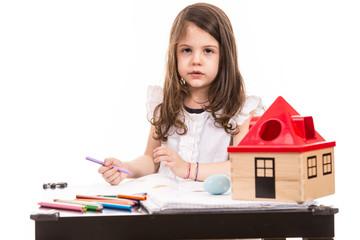 Girl at kindergarten drawing
