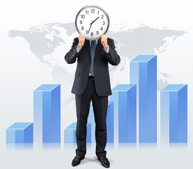 Business. Image of businessman holding alarmclock against