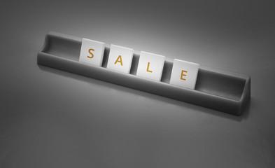 Scrabble tiles spelling the word sale