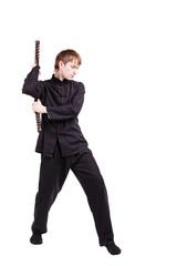Man in a kimono practicing kung fu with nunchaku