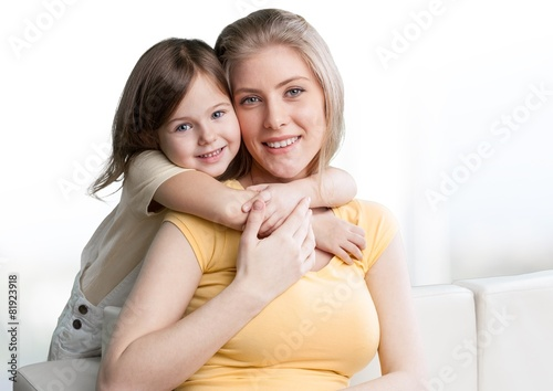 Background. Young daughter closes hands eyes mom - isolated