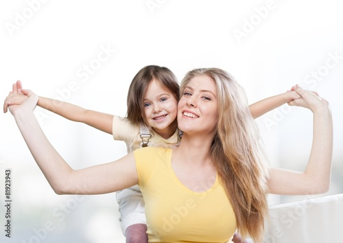 Background. CLoseup portrait of happy  white mother and young