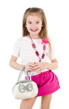 Happy cute little girl in skirt with bag and beads isolated