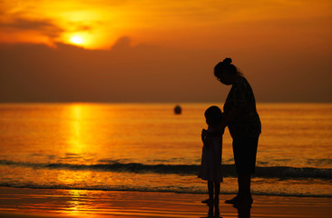 Mother and daughter watching the sunset