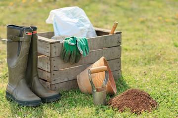 gardening tools on green grass
